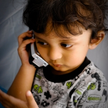 kid talking on phone
